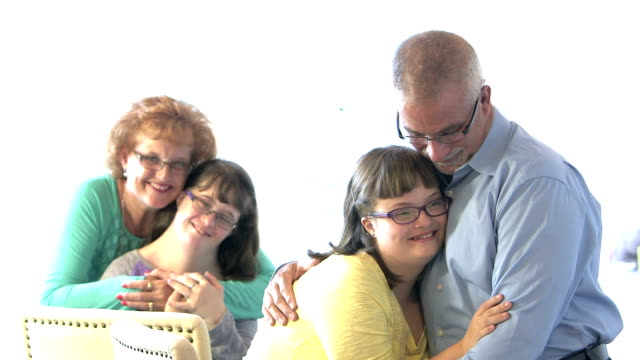 Loving family with two down syndrome children video
