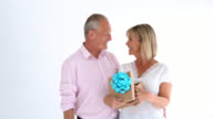 Loving husband surprising his wife with a gift for anniversary video