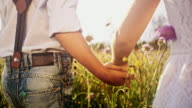 SLO MO Loving kids holding hands in the grass video