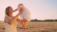 SLO MO Loving mother with her baby in wheat field video