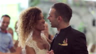 Loving newlywed couple dancing the first dance at wedding video