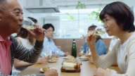 Loving Older Couple Enjoying Wine with Family video