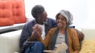 Loving senior African American couple on sofa video