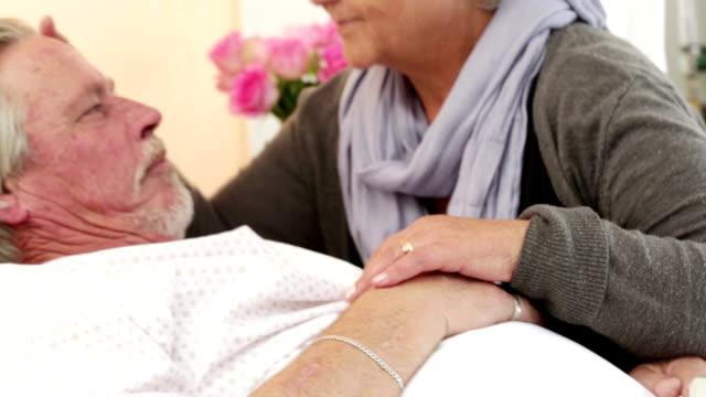 Loving senior couple in hospital room video