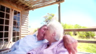 Loving senior couple lying together on a hammock video