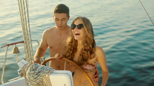 Loving young couple relaxing on a yacht. video