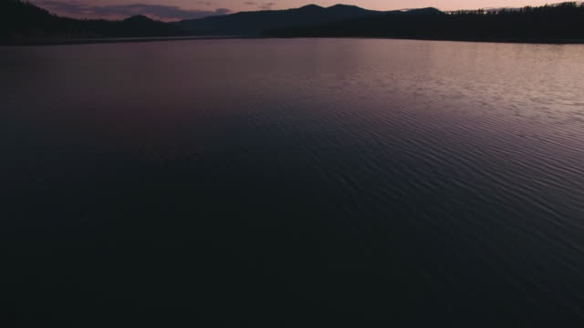 Low Aerial Pan Up to Pink Sunset on Lake Perfect for Movie Intro video