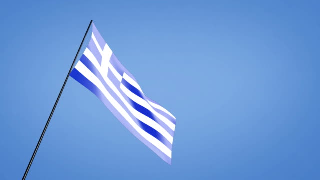 low angle greek flag blue sky video