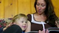low angle of mom reading to son video