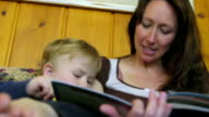 low angle of mother reading to son video