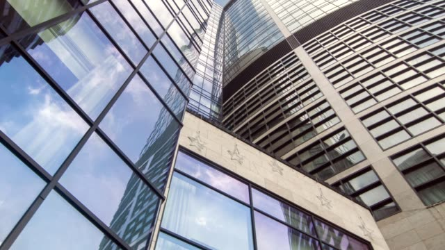 Low angle of tall glass skyscraper video