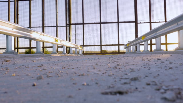 Low Angle Reveals a Gate in a Large Metal Fence on the Borderline video