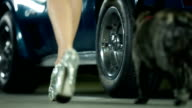 HD: Low angle shot female model stepping out of car video