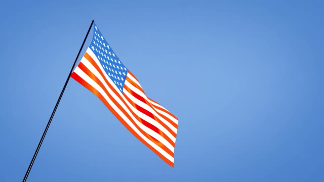 low angle USA flag blue sky video