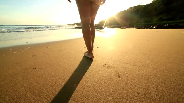Low angle view of barefeet walking on beach video