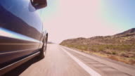 Low Angle View Of Car Driving Along Country Road Shot On R3D video