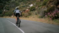 Low angleshot of cyclist busy with cycling fitness training video