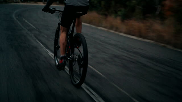 Low angleshot unrecognizable of cyclist riding his bicycle video