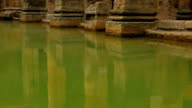 Low panoramic shot of the thermal waters of the Roman spa complex in Bath, UK video