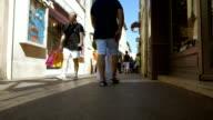 Low shot of foot traffic in St-Tropez Alleyway. video