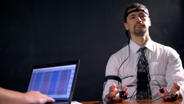 A low view on a relaxed polygraph device. video
