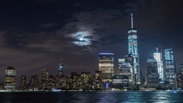 Lower Manhattan and Freedom Tower and Moon New York City Night Timelapse video