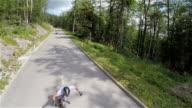Lowering camera overhead of fast longboard riders video