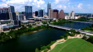 Lowering down on Town Lake Kayakers and Austin Texas Downtown Cityscape Skyline video