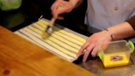 lubrication sticks of dough on a baking tray video