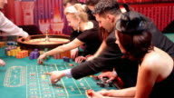 Lucky attractive people having fun at casino. video