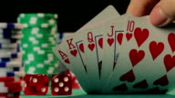 Lucky poker player catches royal flush, successful person wins a video