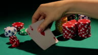 Lucky poker player showing good cards to rivals, winner in video