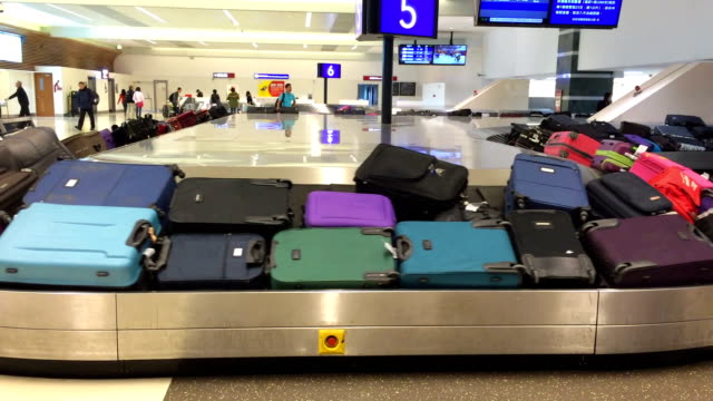 Luggage on baggage carousel after arrived airport video