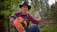 SLO MO Lumberjack with chainsaw giving thumbs up video