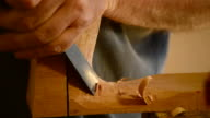 Luthier with chisel working in wood video