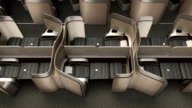Luxurious business class cabin interior with metallic gold partition video