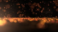 Luxurious gold sparkling particles Bounce Background video