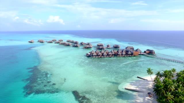 AERIAL: Luxurious overwater villas on tropical island resort video
