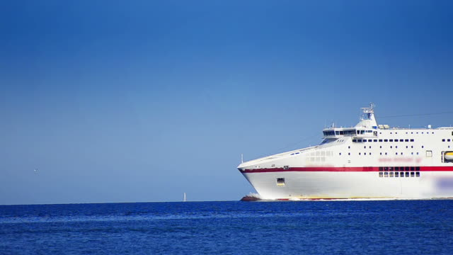 Luxury cruise ship cruising into open sea horizon video