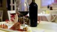 Luxury dinner served on  the table with glass of red wine, horizontal pan, closeup video