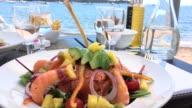 Luxury fresh lunch front of Mediterranean sea video