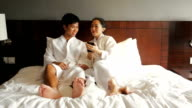 Luxury Happy Asian Couple Relaxing in Bed video
