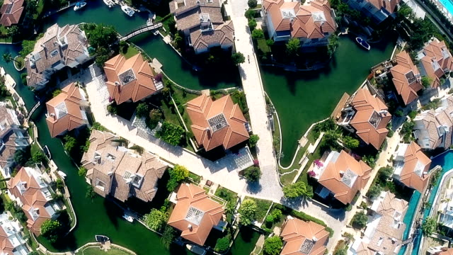 luxury houses by the sea with artificial canals for boats video