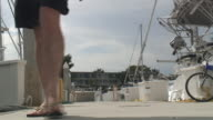 (HD1080i) Luxury Lifestyle: Man on Boat Dock - Coming video