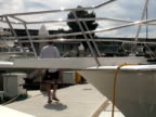 Luxury Lifestyle: Man on Dock - Passes Boat Bow video