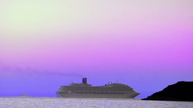 Luxury passinger cruise ship cruising into sea horizon behing the island reef video