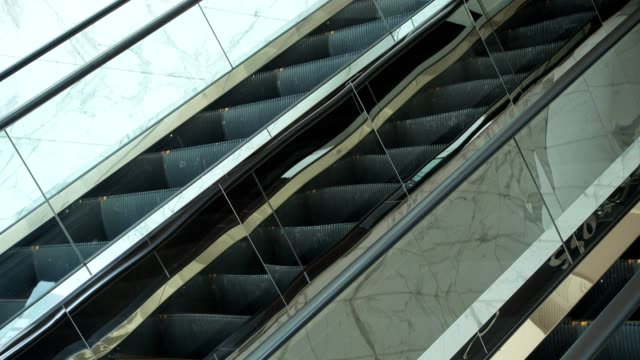 luxury reflective escalator with stone wall video