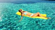 Luxury Resort Vacation. Sexy Woman in Bikini Sunbathing video