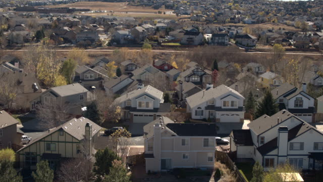 AERIAL, CLOSE UP: Luxury row houses with beautiful backyards in sunny suburbs video