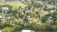 AERIAL: Luxury suburban houses in modern American neighborhood on sunny day video